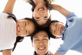Young Chinese Family Looking Down Into Camera — Stock Photo
