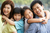 Portrait Of Chinese Family Relaxing In Park Together — Stock Photo