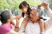 Chinese Grandparents Giving Granddaughter Ride On Shoulders — Foto Stock