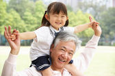 Chinese Grandfather Giving Granddaughter Ride On Shoulders In Pa — Stock Photo