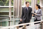 Two Business Colleagues Having Discussion Whilst Walking Outside — Stock Photo