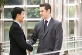 Two Businessmen Shaking Hands Outside Office — Stock Photo