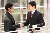 Two Chinese Businessmen Shaking Hands Outside Office — Stock Photo