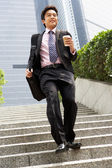 Chinese Businessman Rushing Down Steps Carrying Bag And Takeaway — Stock Photo