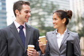 Businessman And Businesswoman Chatting In Street Holding Takeawa — Stock Photo
