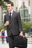 Businessman Walking Along Street Holding Takeaway Coffee — Stock Photo