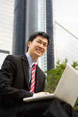 Chinese Businessman Working On Laptop Outside Office — Stock Photo