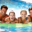 Group Of Friends Having Fun In Swimming Pool — Stockfoto