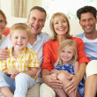 Stock Photo: Multi Generation Family Relaxing On SofAt Home
