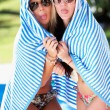 Two Women Wrapped In Towel Standing By Swimming Pool - Foto de Stock