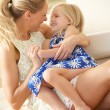 Mother Relaxing At Home With Daughter — Stock Photo