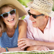 Senior Couple Relaxing In Summer Garden — Stock Photo