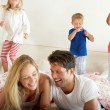 Family Relaxing Together In Bed — Foto de Stock