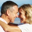 Senior Couple Enjoying Romantic Beach Holiday — Stock Photo #24638313