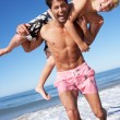 Father And Son Having Fun On Beach — Stock Photo #24638315