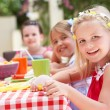 Group Of Children Enjoying Outdoor Tea Party — Stock Photo #24638363