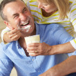 Senior Woman Feeding Husband Ice Cream — Stock Photo #24638365