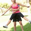 Senior Man Lifting Woman During excercise,fitness, In Park — Stock Photo