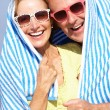 Stock Photo: Senior Couple Sheltering From Sun On Beach Holiday