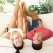 Couple Lying Upside Down On Sofa — Stock Photo