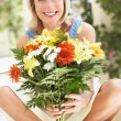 Stock Photo: Senior WomWith Bunch Of Flowers