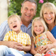 Stock Photo: Grandparents And Grandchildren Sitting On SofTogether