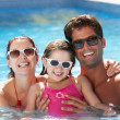 Family Having Fun In Swimming Pool — Stock Photo