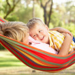 Stock Photo: Two Boys Relaxing In Hammock