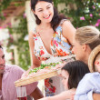 Woman Serving At Family Meal — Stock Photo