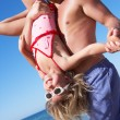 Father And Daughter Having Fun On Beach - Stock fotografie