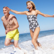 Stock Photo: Senior Couple Enjoying Beach Holiday