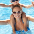Mother And Son Having Fun In Swimming Pool — Stock Photo