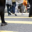 Close Up Of Commuters Feet Crossing Busy Hong Kong Street - Lizenzfreies Foto