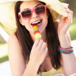 Stock Photo: WomRelaxing In Garden Eating Ice Lolly