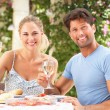 Stock Photo: Couple Enjoying Meal outdoorss