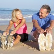 Senior Couple Exercising On Beach — Stock Photo