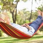 Senior Man Relaxing In Hammock — Stock Photo #24638767