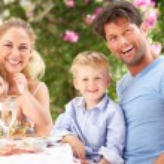 Family Enjoying Meal outdoorss — Stock Photo #24638789