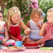 Group Of Children Eating Jelly At Outdoor Tea Party — Stock Photo