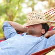 Man Relaxing In Hammock — Stock Photo #24638847