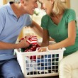 Senior Couple Sorting Laundry Together - Foto Stock