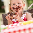 Messy Girl Eating Chocolate Cake — Stock Photo