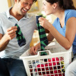 Couple Sorting Laundry In Kitchen — Stock Photo #24638935
