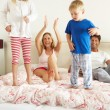 Family Relaxing Together In Bed — Stock Photo #24638937