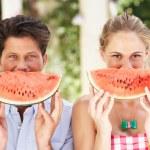 Couple Enjoying Slices Of Water Melon — Stock Photo #24638939