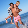 Father And Son Having Fun On Beach — Stock Photo