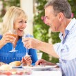 Stock Photo: Senior Couple Enjoying Meal outdoorss