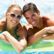 Stock Photo: Couple Having Fun In Swimming Pool