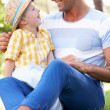 Father And Son Relaxing In Summer Garden — Stock Photo