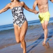 Senior Couple Enjoying Beach Holiday — Stock Photo #24639009